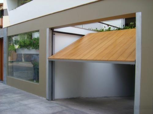 Puertas levadizas para el garage detalles arquitectura for Puertas de madera para garage